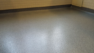 Stronghold Floors installed quartz epoxy in commercial bathroom.