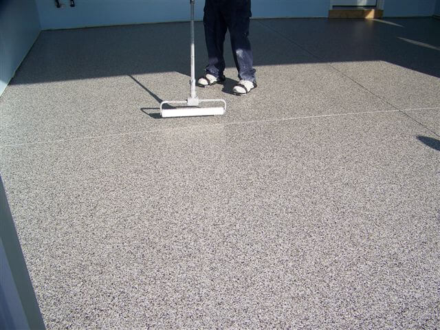 Applying polyaspartic top floor coating in York Pennsylvania