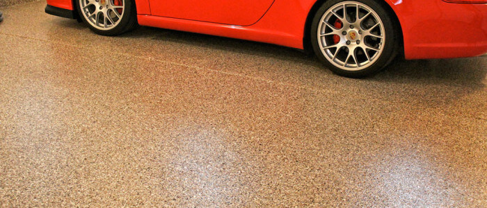 Garage floor coatings for Porsche enthusiasts in Montgomery county by Stronghold Floors.