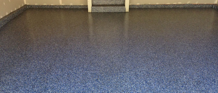 Awesome epoxy flake garage flooring installed in Lutherville, Maryland by Stronghold Floors.