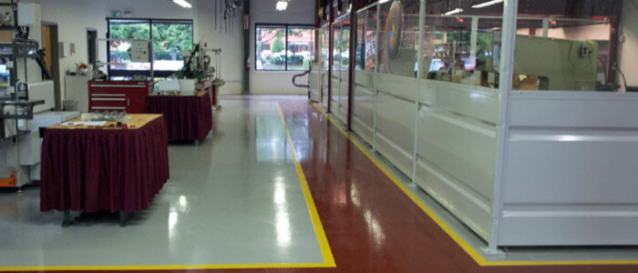 Epoxy coatings installed on production floor by Stronghold Floors.