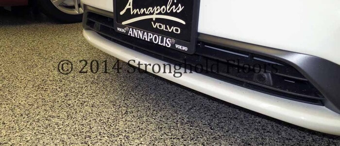 Epoxy commercial coatings applied to Annapolis car dealership garage.