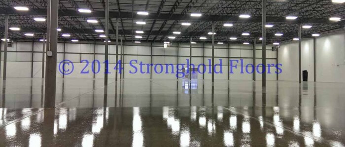 Clear, epoxy coatings in Philadelphia area warehouse by Stronghold Floors.