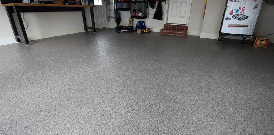 Lancaster garage has epoxy coatings from Stronghold Floors.