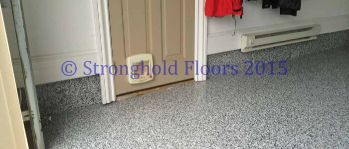 Beautiful faux terrazzo, chip floor coatings protect this McLean garage. Coatings consist of epoxy and polyaspartic urethane.