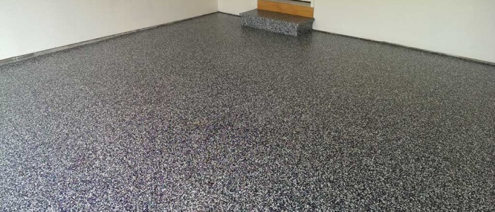 State College garage floor sports epoxy coatings with Penn State colors.