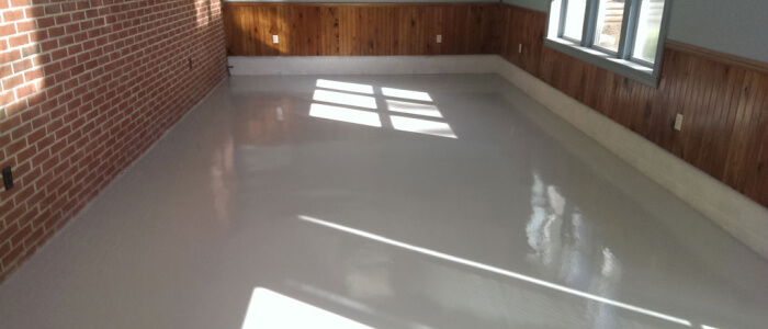 Dover basement replaces carpet with epoxy coatings from Stronghold Floors.
